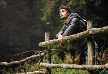 Guy on a hike, alone.