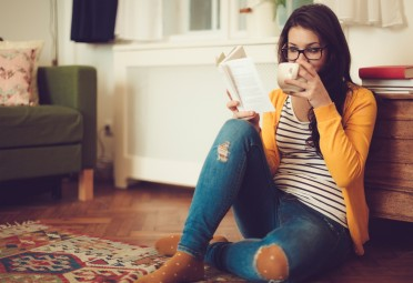 Girl Relaxing With Book and Drink