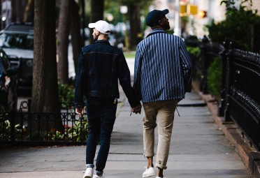 Two guys in a relationship holding hands