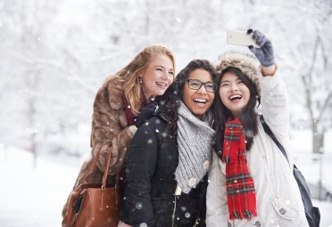 Three women posing for a selfie in the winter