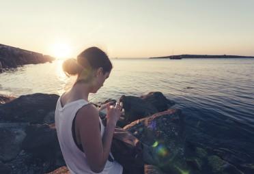 Girl Sitting by Ocean