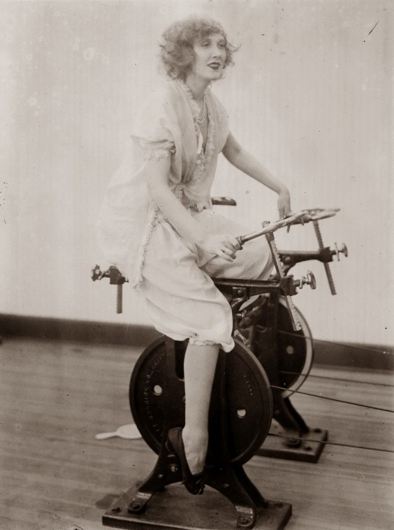 Woman on Old-Fashioned Stationary Bike