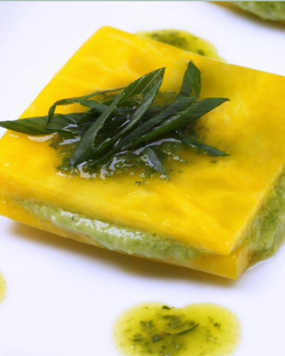 Raw Golden Beet Ravioli With English Pea Puree and Herb Oil