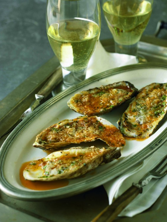 oysters grilled with roasted garlic butter and romano