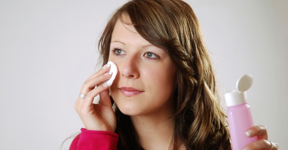 Woman Using Apple Cider Vinegar on Her Face