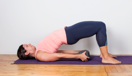 "The Perfect Yoga ""Workout"" for When You're Too Sore to Work Out: Bridge"