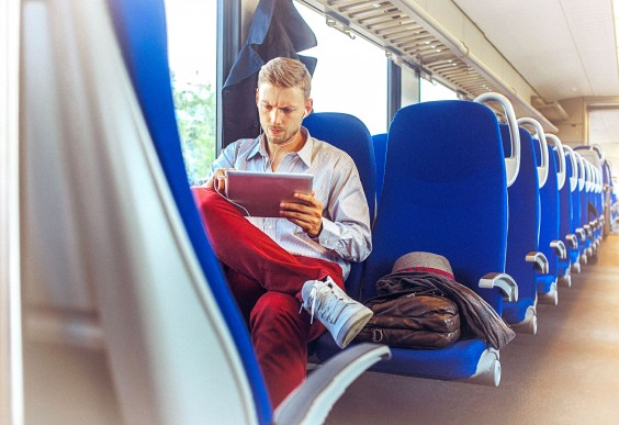 Man on iPad While on the Train