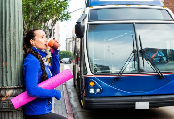 Woman With a Yoga Mat Drinking Coffee