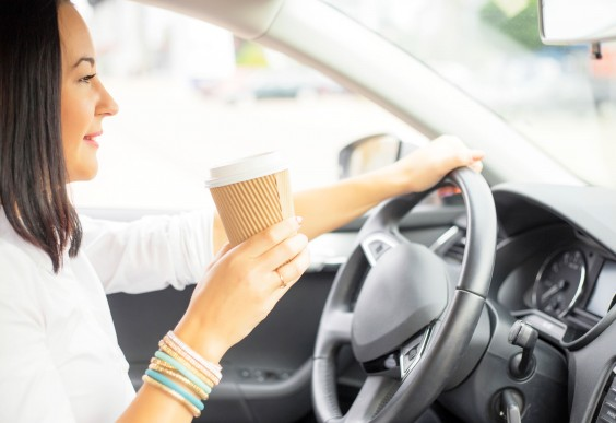 Woman Drinking Coffee and Driving