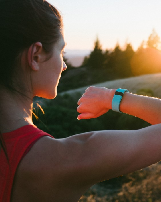Young Woman Wearing Fitbit to Count Steps