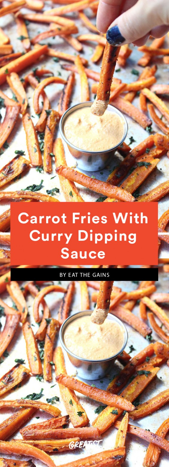 Julienned carrots on a baking sheet with a small aluminum bowl of white dipping sauce. This is a Whole30 compliant dish.