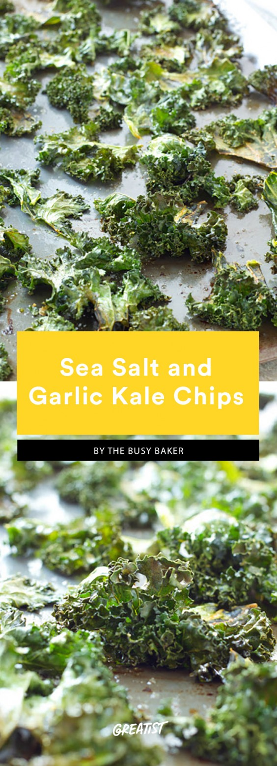 Baked kale with salt, oil, and garlic powder on a baking sheet. This is a Whole30 compliant dish.