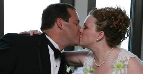 Husband and Wife Kissing at Wedding