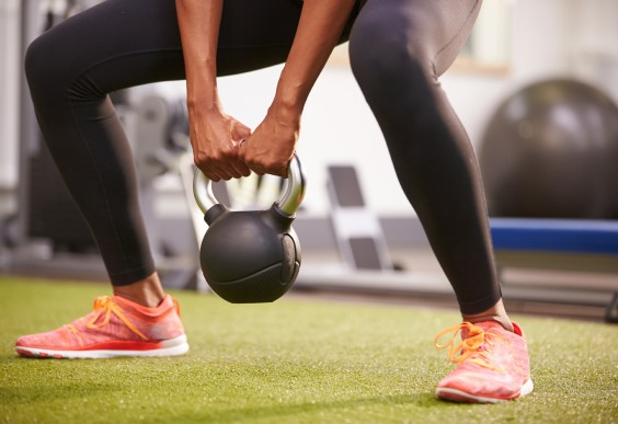 Woman About to Lift a Kettlebell