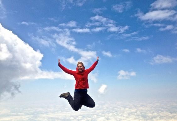 The author, Masha, jumping off Kilimanjaro, seemingly floating mid-air