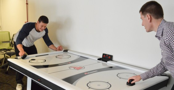 NutraClick Employees Playing Air Hockey