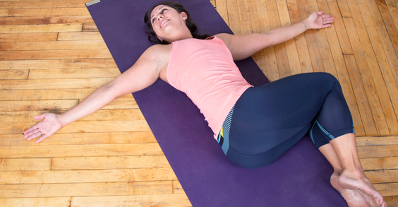 The Perfect Yoga Workout for When You're Too Sore to Work Out: Reclined Spinal Rotation