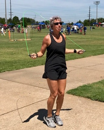 Erin, fitting a workout into her busy schedule at her kid's soccer game.