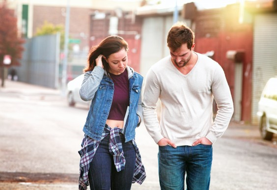 Young Serious Couple in Urban Setting