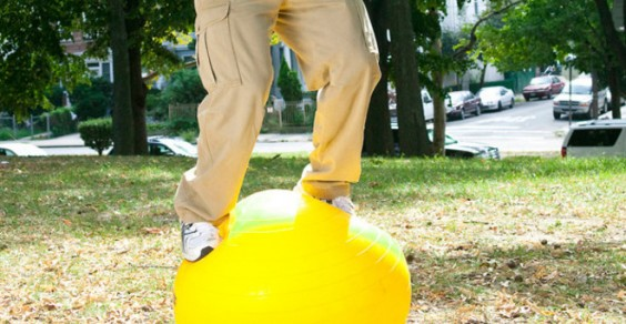 Some people work out on Swiss balls. Meet the guy who stands on them—for hours