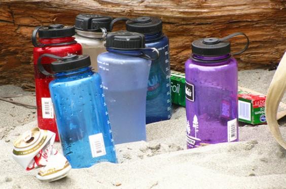 Waterbottles On Beach