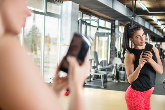 Woman Taking a Selfie at the Gym