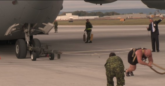Yes, that man is pulling a cargo plane. Not big deal