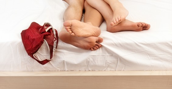Naked Couple's Feet in Bed