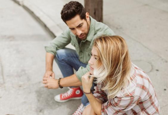 Friends Sitting on a Curb