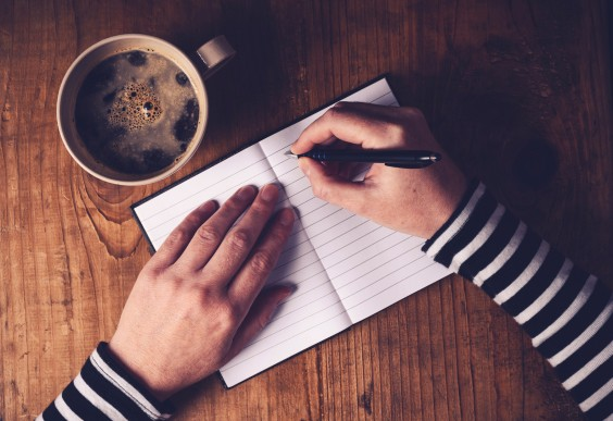 Life Lessons: Hands journaling with coffee