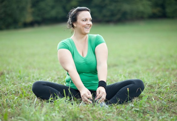 Happy Woman Stretching in Field