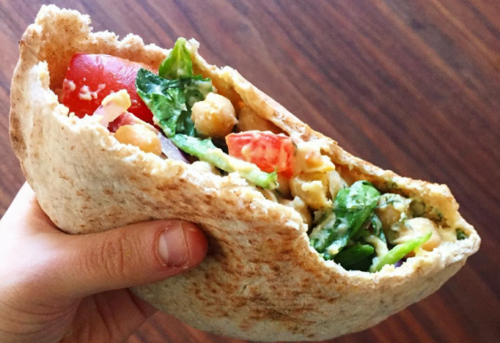 A pita pocket filled with healthy, tasty things.