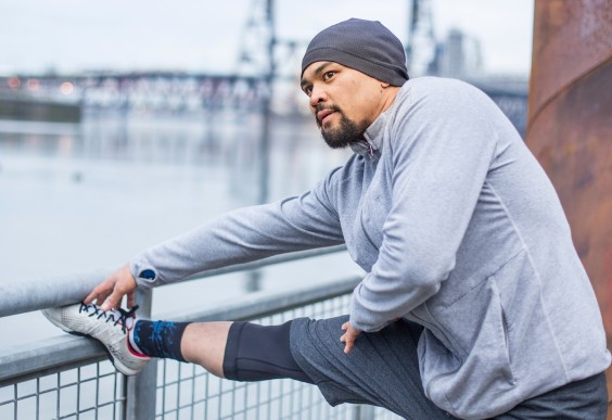 Man Stretching Before a Run