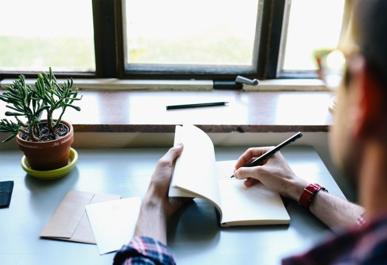 Thoughtful Man Writing