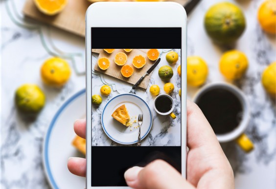 Food Policy: hand taking picture of food with smartphone