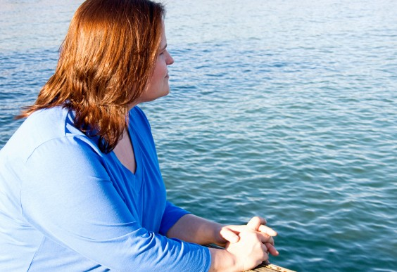 On Concern for Your Fat Friend's Health: Woman looking out over the sea