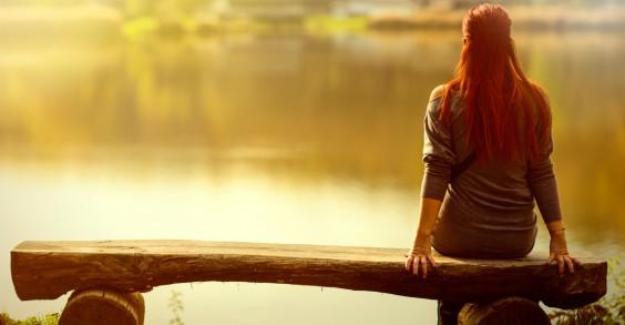 Woman Thinking by Lake