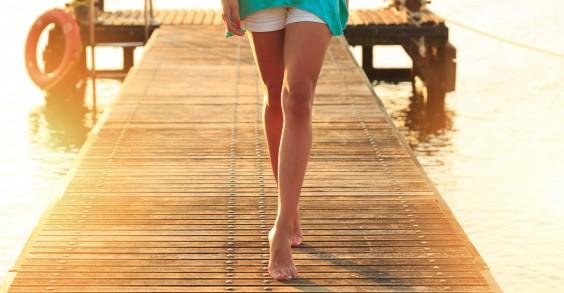 Woman Walking on Dock