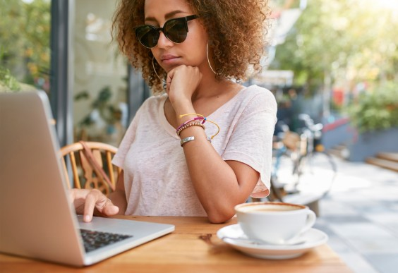 Woman Writing at Cafe