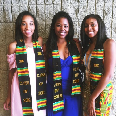 The author (middle) with her friends at her school's black graduation ceremony.