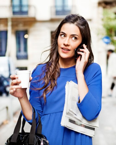 Busy Young Woman on Cell Phone