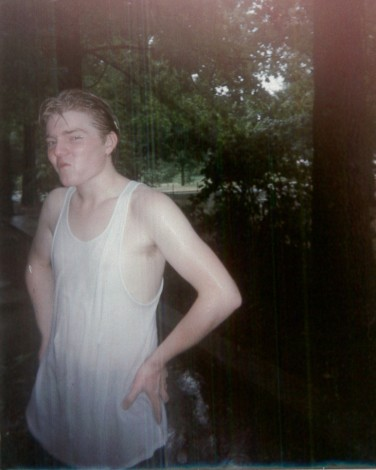 Sean, the author, in high school, wearing a white tank top