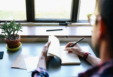 Man journaling.