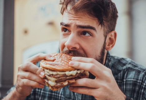 Guy Eating Burger