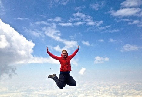 The author, Masha, jumping off Kilimanjaro, seemingly floating mid-air