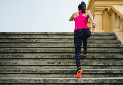 Young Woman Running Stairs
