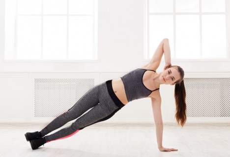 Woman holding a side plank