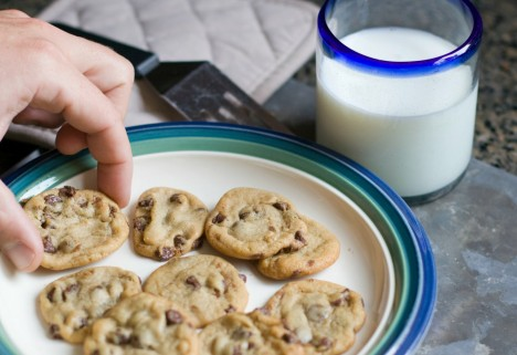 hand reaching for chocolate chip cookie
