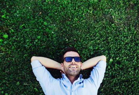 Happy Man Lying on Grass