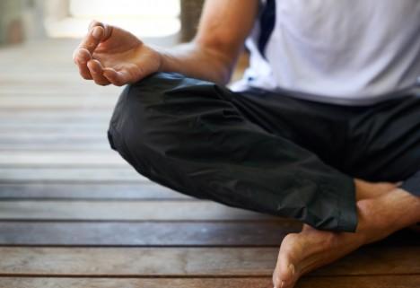 Man meditating on a porch